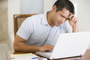 Asian-Guy-Laptop-Stressed